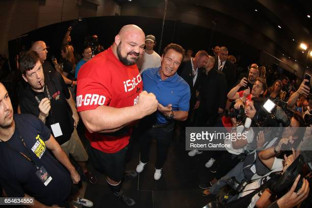 Arnold Schwarzenegger poses with strongman Brian Shaw during the 2017 Arnold Classic at The Melbourne Convention and Exhibition Centre on March 17...