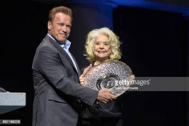 Arnold Schwarzenegger presents Betty Weider with the Lifetime Achievement Award during the Arnold Classic as part of the Arnold Sports Festival on...