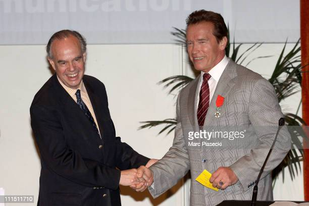 Arnold Schwarzenegger receives the 'insigne de chevalier dans l'ordre de la legion d'honneur' during the MIPTV 2011 by French Minister Of Culture...