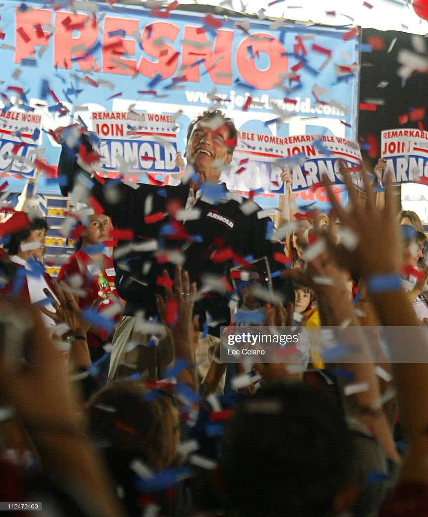 Arnold Schwarzenegger, Republican candidate in the California recall election, throws a t-shirt to the crowd the crowd during a rally in Clovis, Calif. on day three of his four-day bus tour of the state Oct. 2, 2003.