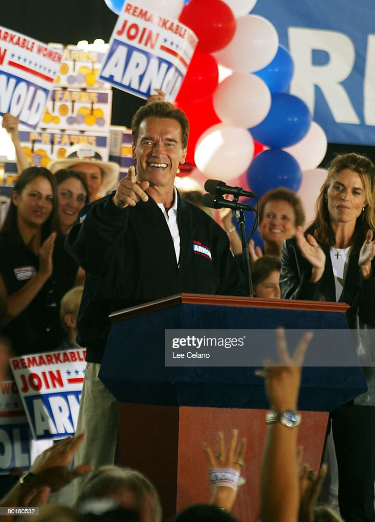Arnold Schwarzenegger, Republican candidate in the California recall election, and wife Maria Shriver greet the crowd during a rally in Clovis, Calif. on day three of his four-day bus tour of the state Oct. 2, 2003.
