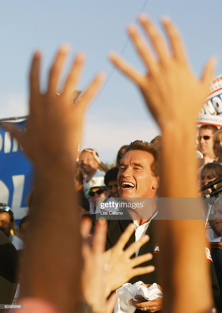 Arnold Schwarzenegger, Republican candidate in the California recall election, greets the crowd during a rally in Pleasanton, Calif. on day three of his four-day bus tour of the state Oct. 2, 2003.