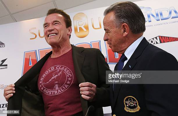 Arnold Schwarzenegger shows off a tee shirt to the media during the Arnold Classic press conference at The Melbourne Convention and Exhibition Centre...