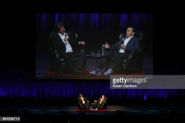 Arnold Schwarzenegger speaks on stage with Richard Wilkins during the Arnold Classic Australia Business Forum at The Melbourne Convention and...