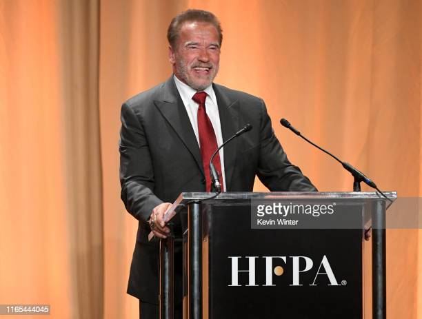 Arnold Schwarzenegger speaks onstage during Hollywood Foreign Press Association's Annual Grants Banquet at Regent Beverly Wilshire Hotel on July 31...