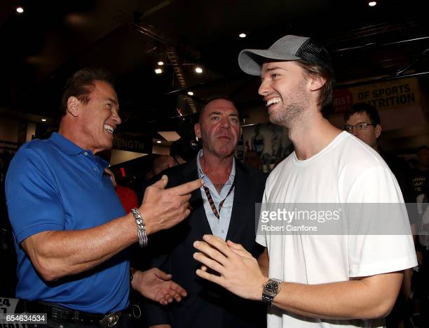 Arnold Schwarzenegger speaks with his son Patrick and event promoter Tony Doherty during the 2017 Arnold Classic at The Melbourne Convention and...