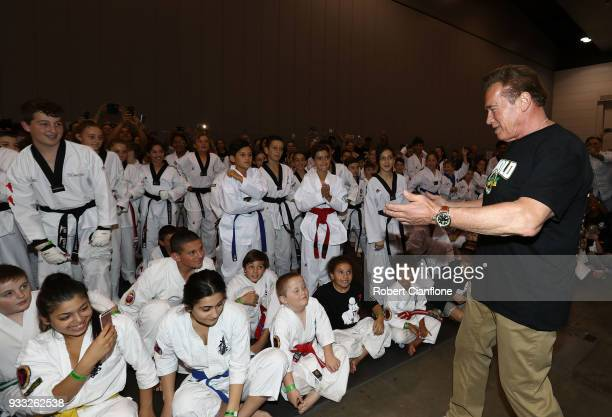 Arnold Schwarzenegger speaks with martial art athletes during the Arnold Sports Festival Australia at The Melbourne Convention and Exhibition Centre...