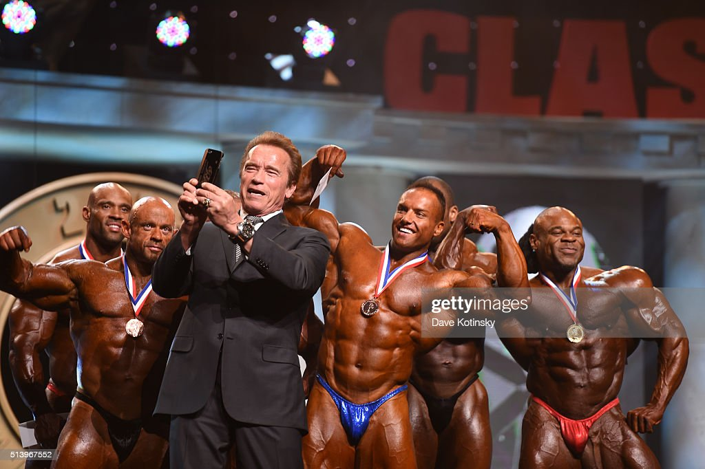 Arnold Schwarzenegger takes a photo with then winner's of the Arnold Classic at the Arnold Sports Festival 2016 on March 5, 2016 in Columbus, Ohio.