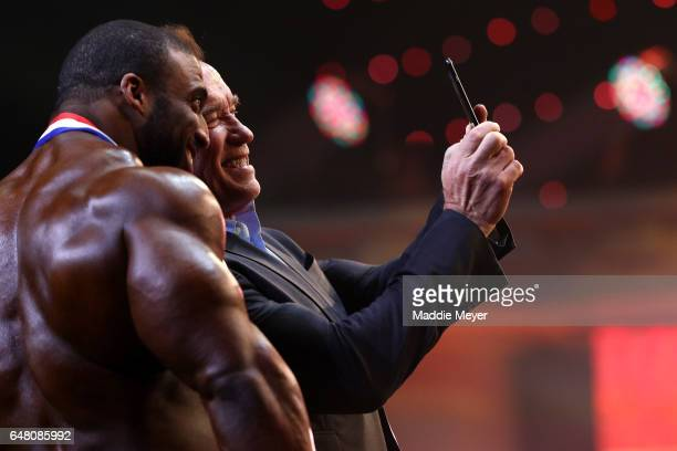 Arnold Schwarzenegger takes a selfie with Arnold Classic winner Cedric McMillan at the Greater Columbus Convention Center during the Arnold Sports...