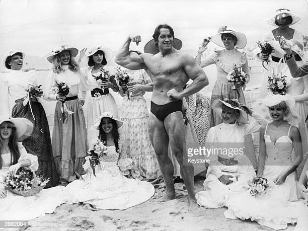 Arnold Schwarzenegger, the film actor who first became famous as Mr Universe for his magnificent physique, on Cannes beach during the Film Festival...