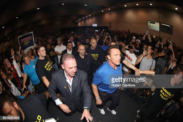 Arnold Schwarzenegger walks through the crowds on the expo floor during the 2017 Arnold Classic at The Melbourne Convention and Exhibition Centre on...