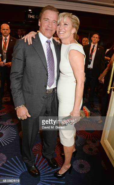 Arnold Schwarzenegger winner of The Action Hero Of Our Lifetime award and Emma Thompson winner of the Best Actress award pose in the press room at...