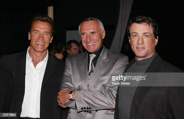 Arnold Schwarzenegger WSA/Red Bull Energy Drink creato and founder Dietrich Mateschitz and Sylvester Stallone at the '2002 World Stunt Awards' at...