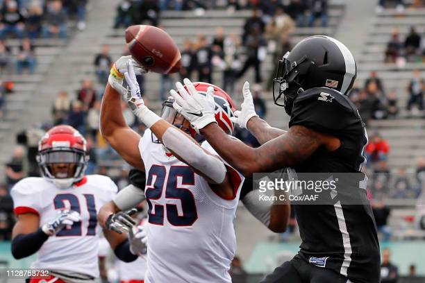 Arnold Tarpley, III of Memphis Express breaks up a pass intended for Amba Etta-Tawo of Birmingham Iron during an Alliance of American Football game...
