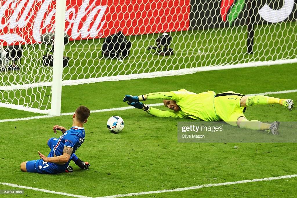 Arnor Ingvi Traustason of Iceland scores passed Robert Almer of Austria for his team's second goal during the UEFA EURO 2016 Group F match between Iceland and Austria at Stade de France on June 22, 2016 in Paris, France.