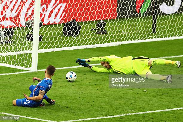 Arnor Ingvi Traustason of Iceland scores passed Robert Almer of Austria for his team's second goal during the UEFA EURO 2016 Group F match between...
