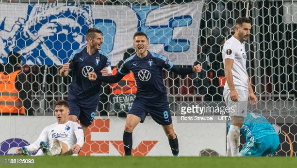 Arnor Ingvi Traustason of Malmo FF celebrates with team mates after scoring his team's first goal during the UEFA Europa League group B match between...