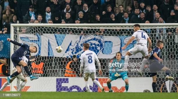 Arnor Ingvi Traustason of Malmo FF scores his team's first goal past goalkeeper Karl-Johan Johnsson of FC Kobenhavn during the UEFA Europa League...