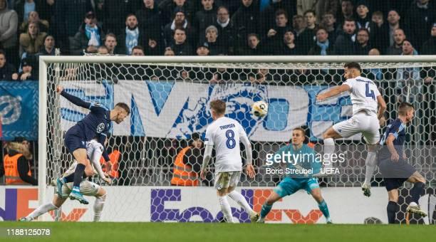 Arnor Ingvi Traustason of Malmo FF scores his team's first goal past goalkeeper KarlJohan Johnsson of FC Kobenhavn during the UEFA Europa League...