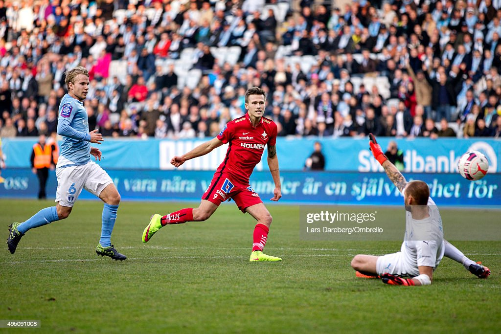 Arnor Ingvi Traustason score 2-0 behind Johan Wiland during the match between Malmo FF and IFK Norrkoping at Swedbank Stadion on October 31, 2015 in Malmo, Sweden.
