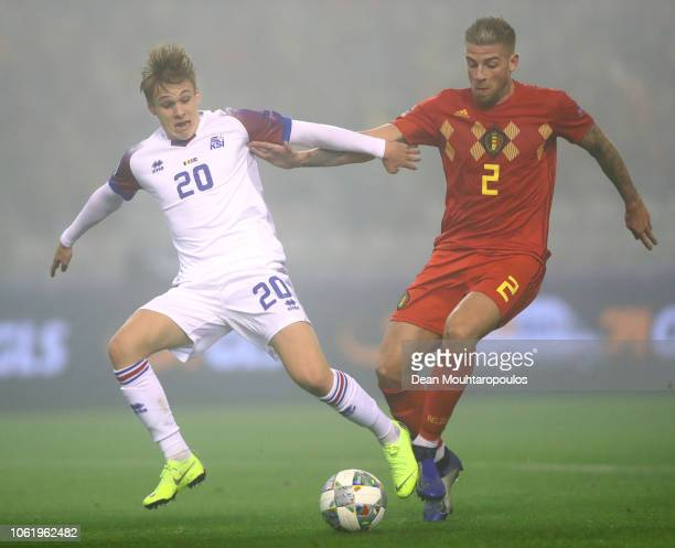 Arnor Sigurdsson of Iceland is challenged by Toby Alderweireld of Belgium during the UEFA Nations League A group two match between Belgium and...
