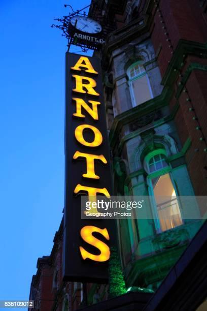 Arnotts department store shop sign at night, Dublin, Ireland, Republic of Ireland.