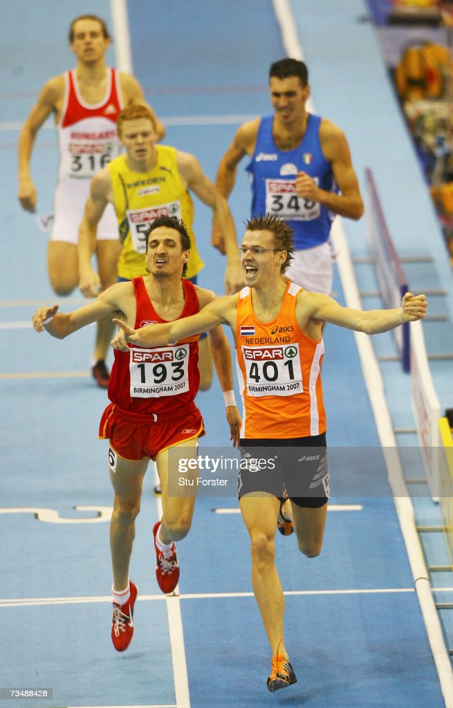 Arnoud Okken of the Netherlands (401) celerbates as he wins gold ahead of Miguel Quesada of Spain (193) during the Men's 800 Metres Final on day three of the 29th European Athletics Indoor Championships at the National Indoor Arena on March 4, 2007 in Birmingham, England.