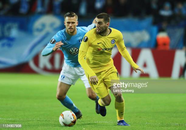 Arnór Ingvi Traustason of Malmo FF and Mateo Kovacic during the UEFA Europa League Round of 32 First Leg match between Malmo FF and Chelsea at Malmoe...
