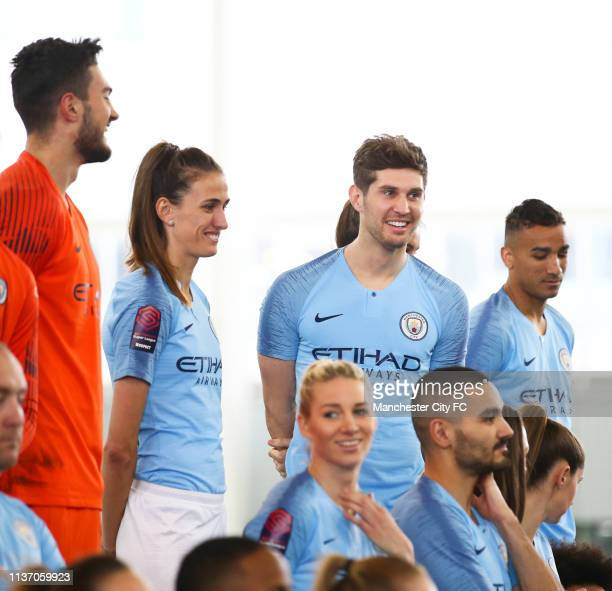 Aro Muric Jill Scott and John Stones of Manchester City interact during the photo shoot at Manchester City Football Academy on March 15 2019 in...