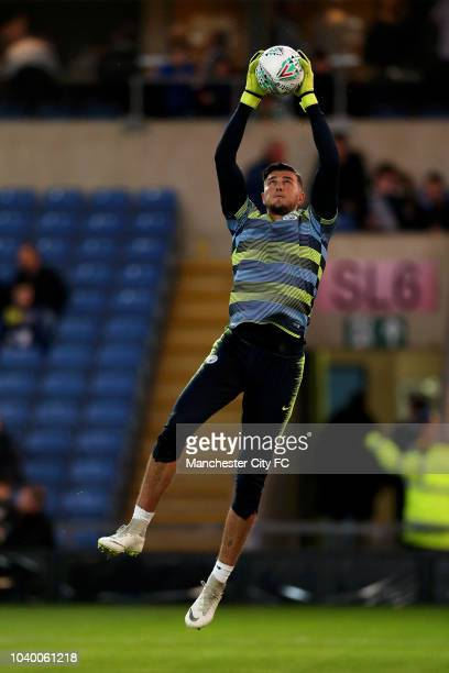 Aro Muric of Manchester City warms up prior to the Carabao Cup Third Round match between Oxford United and Manchester City at Kassam Stadium on...