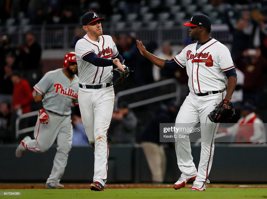 Arodys Vizcaino #38 of the Atlanta Braves reacts with Freddie Freeman #5 after the final out in their 2-1 win over the Philadelphia Phillies at SunTrust Park on April 16, 2018 in Atlanta, Georgia.