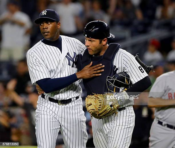 Aroldis Chapman and Austin Romine of the New York Yankees celebrate the 3-1 win over the Boston Red Sox at Yankee Stadium on July 17, 2016 in the...