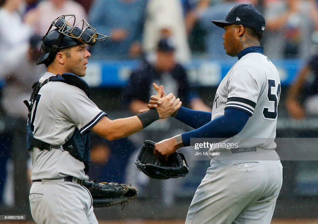 Aroldis Chapman #54 and Austin Romine #27 of the New York Yankees celebrate after defeating the Tampa Bay Rays at Citi Field on September 13, 2017 in the Flushing neighborhood of the Queens borough of New York City. The two teams were scheduled to play in St. Petersburg, Florida but due to the weather emergency caused by Hurricane Irma, the game was moved to New York, but with Tampa Bay remaining the 'home' team.