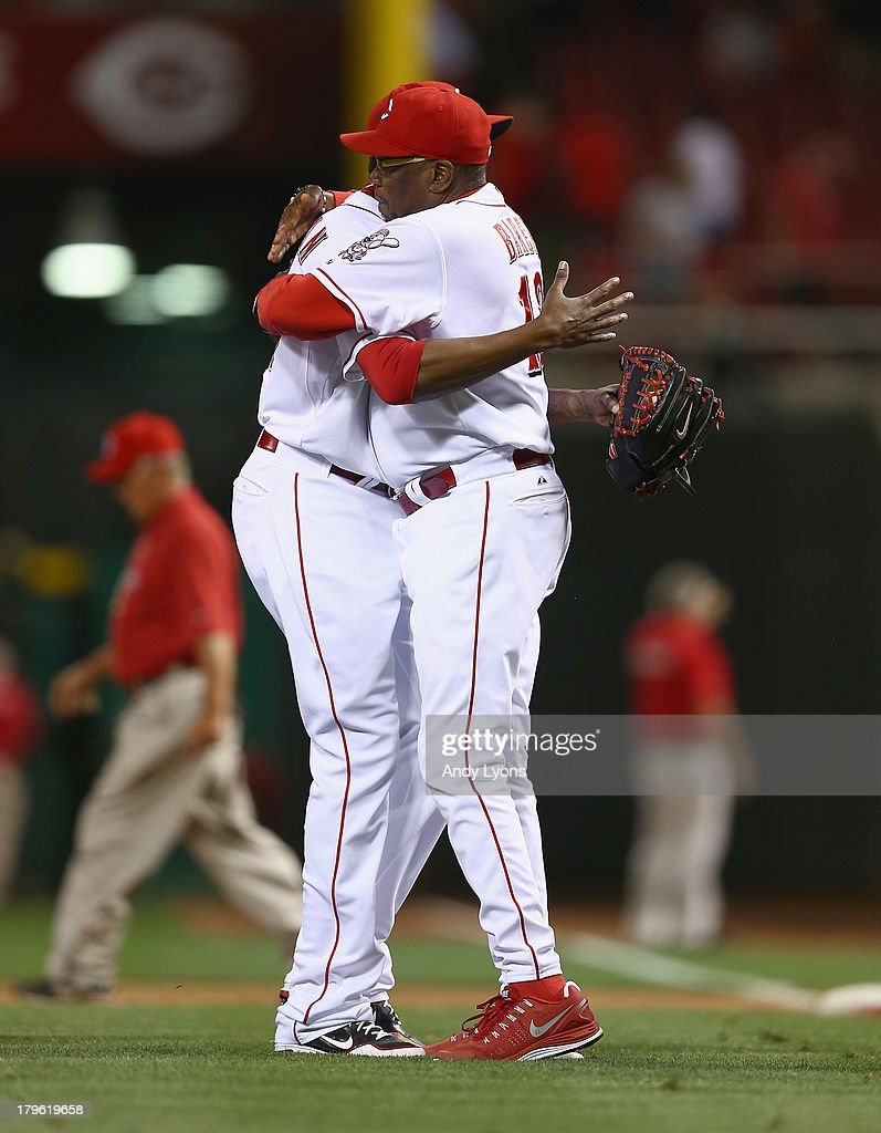 Aroldis Chapman #54 and Dusty Baker the manager of the Cincinnati Reds hug after the game against the St. Louis Cardinals at Great American Ball Park on September 5, 2013 in Cincinnati, Ohio.