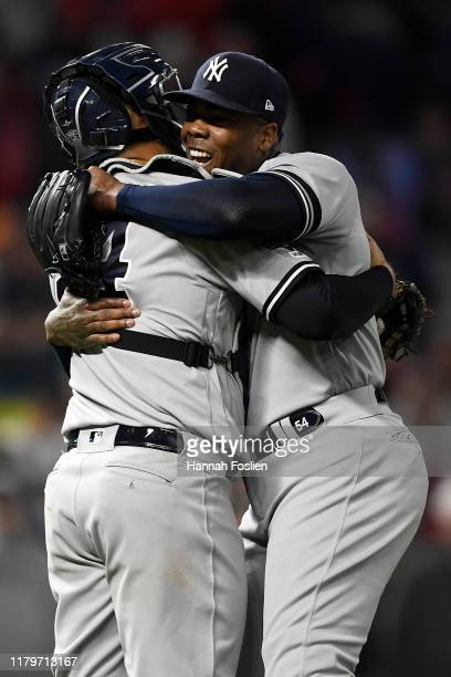 Aroldis Chapman and Gary Sanchez of the New York Yankees celebrate after defeating the Minnesota Twins 5-1 in game three of the American League...