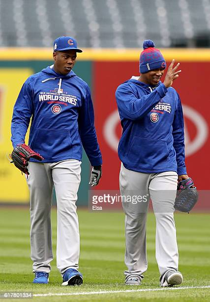 Aroldis Chapman and Pedro Strop of the Chicago Cubs walk the field during Media Day workouts for the 2016 World Series at Progressive Field on...