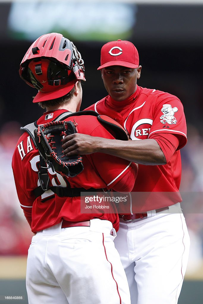Aroldis Chapman #54 and Ryan Hanigan #29 of the Cincinnati Reds celebrate after the final out of the game against the Los Angeles Angels of Anaheim at Great American Ball Park on April 4, 2013 in Cincinnati, Ohio. The Reds won 5-4.