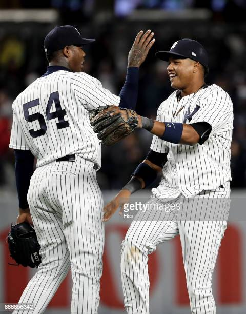 Aroldis Chapman and Starlin Castro of the New York Yankees celebrate the 4-3 win over the St. Louis Cardinals on April 14, 2017 at Yankee Stadium in...