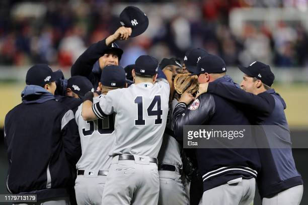 Aroldis Chapman and the New York Yankees celebrate after the final out defeating the Minnesota Twins 51 in game three of the American League Division...