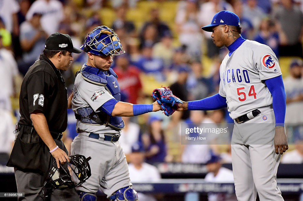 Aroldis Chapman #54 and Willson Contreras #40 of the Chicago Cubs celebrate the Cubs 8-4 victory against the Los Angeles Dodgers in game five of the National League Division Series at Dodger Stadium on October 20, 2016 in Los Angeles, California.