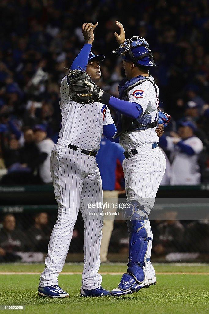 Aroldis Chapman #54 (L) and Willson Contreras #40 of the Chicago Cubs celebrate after beating the Cleveland Indians 3-2 in Game Five of the 2016 World Series at Wrigley Field on October 30, 2016 in Chicago, Illinois.