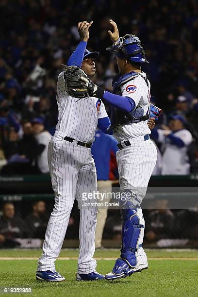 Aroldis Chapman and Willson Contreras of the Chicago Cubs celebrate after beating the Cleveland Indians 3-2 in Game Five of the 2016 World Series at...