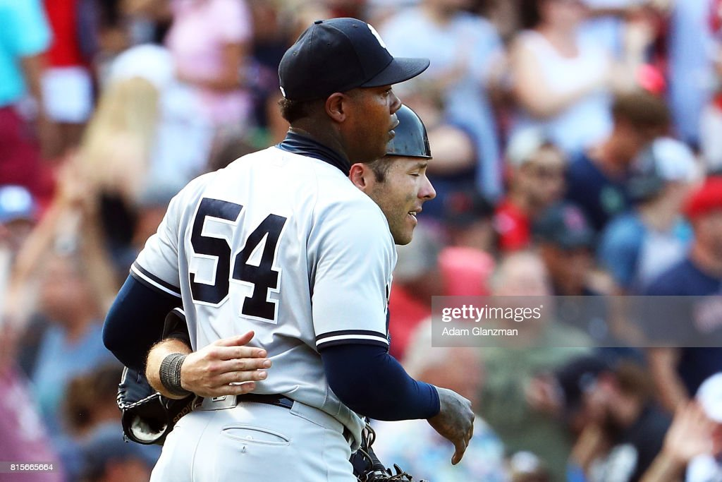 Aroldis Chapman #54 embraces Austin Romine #27 of the New York Yankees after the victory in game one of a doubleheader against the Boston Red Sox at Fenway Park on July 16, 2017 in Boston, Massachusetts.