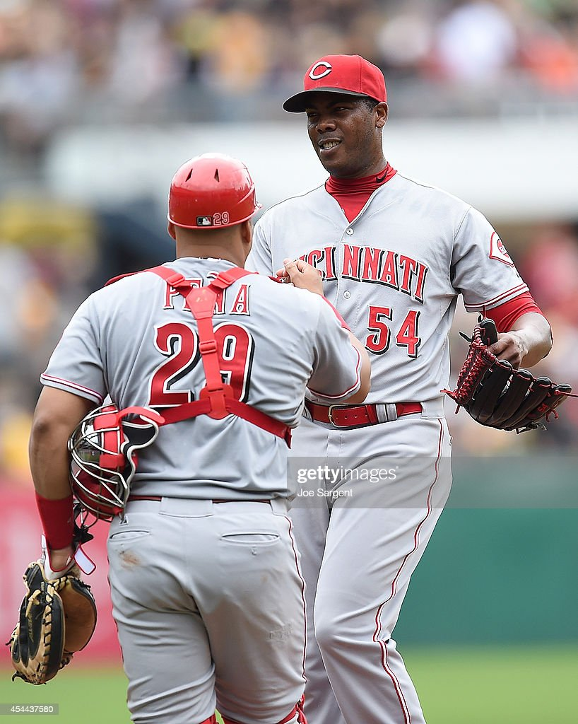Aroldis Chapman #54 is congratulated by Brayan Pena #29 of the Cincinnati Reds after a 3-2 win over the Pittsburgh Pirates on August 31, 2014 at PNC Park in Pittsburgh, Pennsylvania.