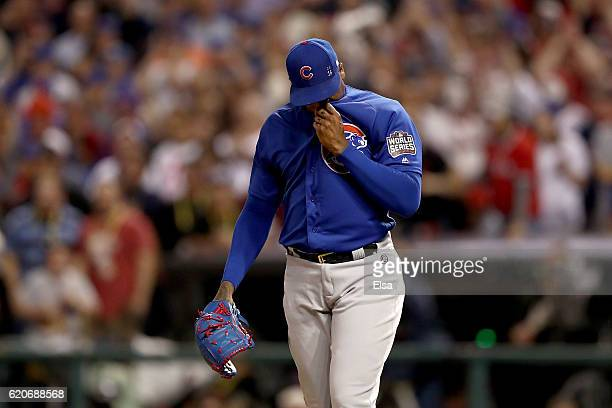 Aroldis Chapman of the Chicago Cubs reacts after Rajai Davis of the Cleveland Indians hit a two-run home run during the eighth inning to tie the game...
