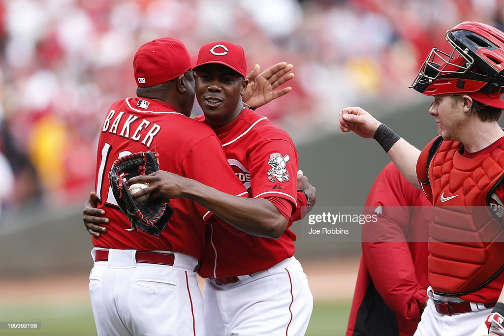 Aroldis Chapman #54 of the Cincinnati Reds gets a hug from manager Dusty Baker #12 after the game against the Washington Nationals at Great American Ball Park on April 7, 2013 in Cincinnati, Ohio. The Reds won 6-3.