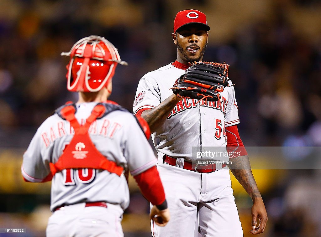 Aroldis Chapman #54 of the Cincinnati Reds is congratulated by teammate Tucker Barnhart #16 following their 3-1 win against the Pittsburgh Pirates during the game at PNC Park on October 3, 2015 in Pittsburgh, Pennsylvania.