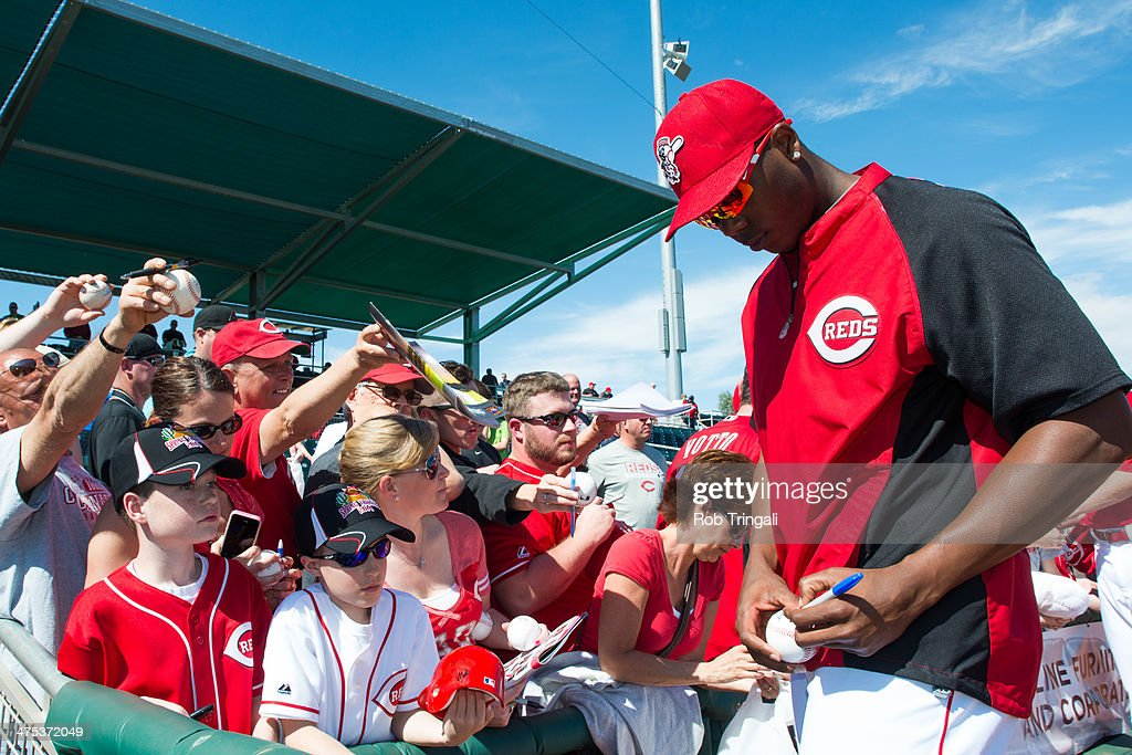 Aroldis Chapman #54 of the Cincinnati Reds signs autographs for fans before the game against the Cleveland Indians at Goodyear Ballpark on February 27, 2014 in Goodyear, Arizona.