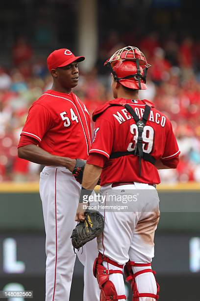 Aroldis Chapman of the Cincinnati Reds talks with catcher Devin Mesoraco against the Minnesota Twins on June 24 2012 at Great American Ball Park in...