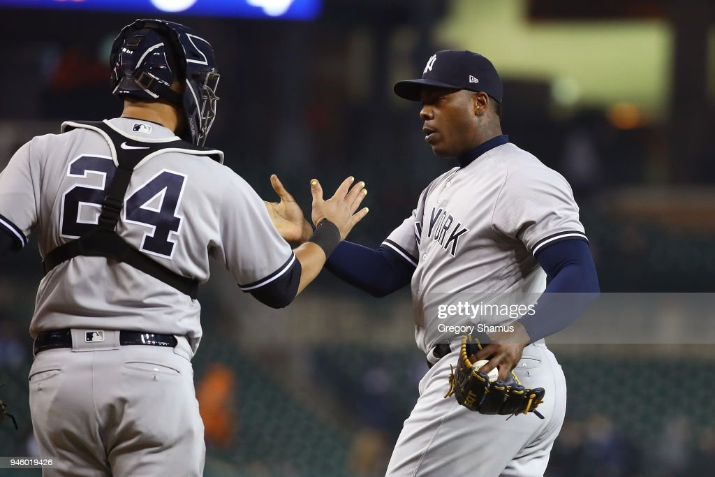 Aroldis Chapman #54 of the New York Yankees celebrates a 8-6 win over the Detroit Tigers with Gary Sanchez #24 at Comerica Park on April 13, 2018 in Detroit, Michigan.